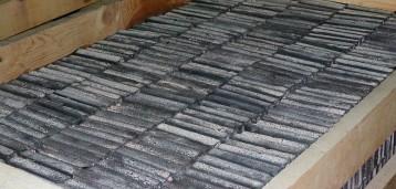 Плиты камнелитые упакованные в деревянный ящик